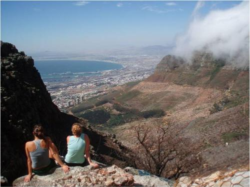 Girls sitting on a mountain in Cape Town
