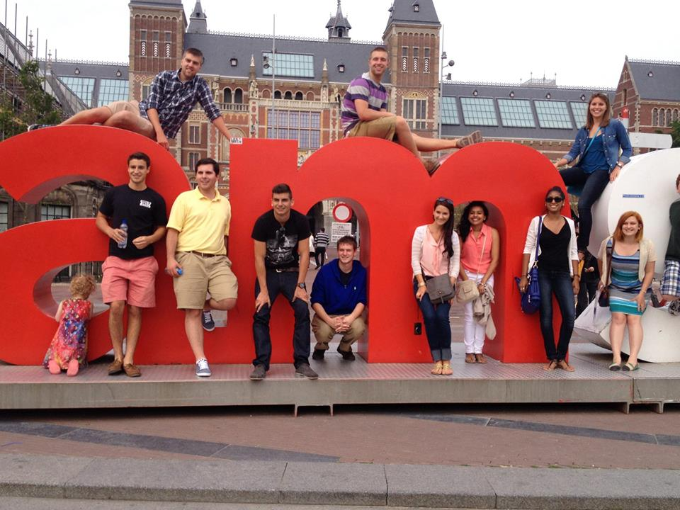 Sudents in front of Amsterdam sign