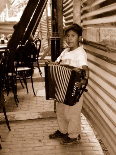 Puebla boy holding an accordian